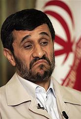 Ahmadinejad frowns