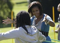 Michelle Obama with a hula hoop