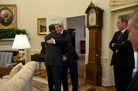Obama and Kerry hug