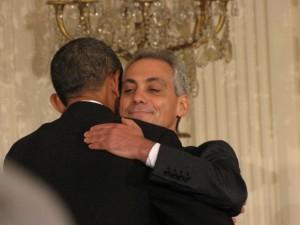 Obama and Rahm Emanuel hug.