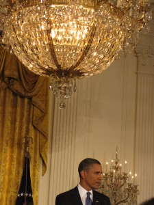 Obama below East Room chandelier