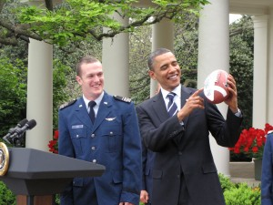 Obama holds football