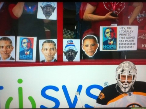Capitals fans taunt Tim Thomas with Obama photos