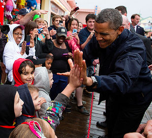 Obama high fives kids