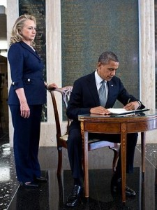 Clinton on September 12, 2012 with Obama as he signs the condolence book at the State Department in memory of Chris Stevens