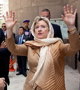Hillary beseeches Allah to save her from scandal.