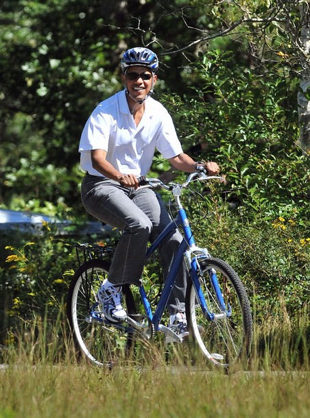 US President Barack Obama rides bicycle
