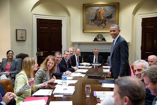 Obama stands