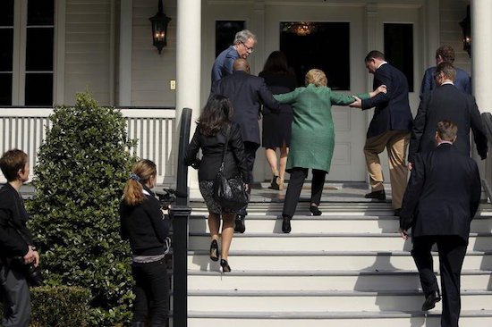 Hillary Clinton trips on stairs